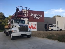 Installing all the new exterior signs for the new Smoothie King location in Denham Springs