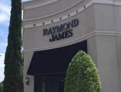 Installing reverse lit channel letters for Raymond James in Town Center