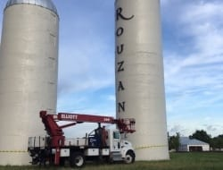 Installing-reverse-lit-letters-on-a-60-ft-silo