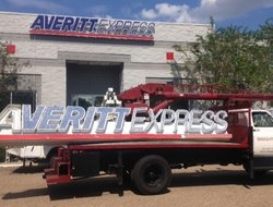 Replacing a new and updated sign for Averitt