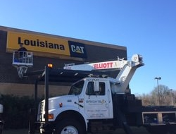 Servicing Louisiana CAT sign with new bulbs